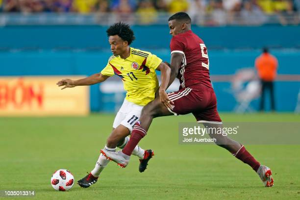 Juan Cuadrado of Colombia brings the ball past Sergio Cordova of Venezuela during an International friendly match on September 7 2018 at Hard Rock...