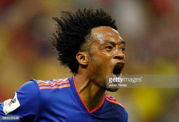 Juan Cuadrado of Colombia celebrates after scoring his team's third goal during the 2018 FIFA World Cup Russia group H match between Poland and...