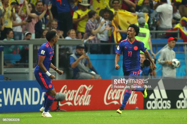 Juan Cuadrado of Colombia celebrates scoring a goal to make it 03 during the 2018 FIFA World Cup Russia group H match between Poland and Colombia at...