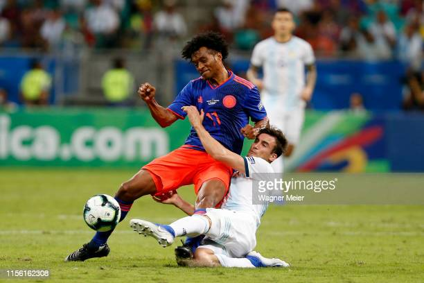 Juan Cuadrado of Colombia fights for the ball with Nicolás Tagliafico of Argentina during the Copa America Brazil 2019 group B match between...