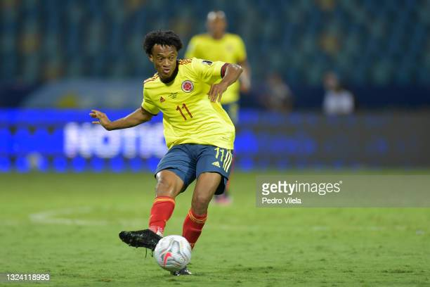 Juan Cuadrado of Colombia kicks the ball during a Group B match between Colombia and Venezuela as part of Copa America Brazil 2021 at Estadio...