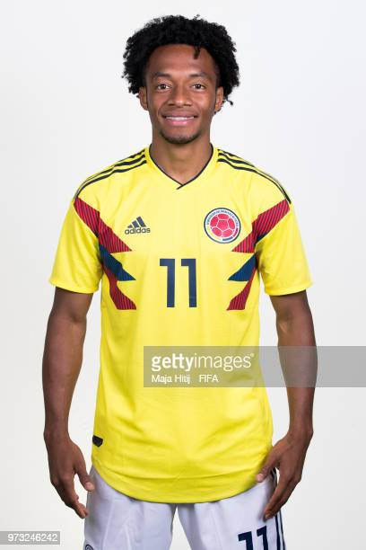 Juan Cuadrado of Colombia poses for a portrait during the official FIFA World Cup 2018 portrait session at Kazan Ski Resort on June 13 2018 in Kazan...