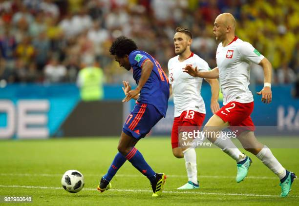 Juan Cuadrado of Colombia scores his team's third goal during the 2018 FIFA World Cup Russia group H match between Poland and Colombia at Kazan Arena...