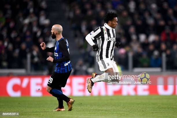 Juan Cuadrado of Juventus and Borja Valero of FC Internazionale compete for the ball during the Serie A match between Juventus and FC Internazionale...