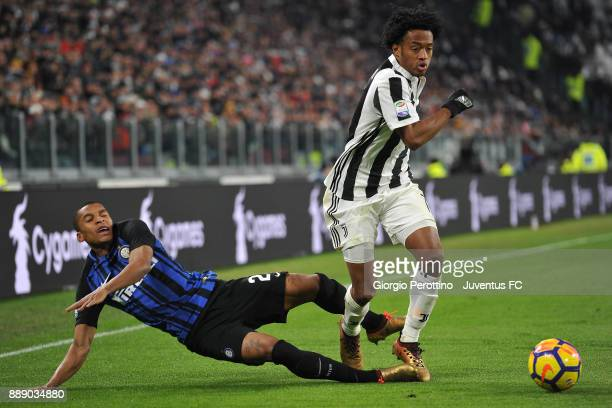 Juan Cuadrado of Juventus and Dalbert Henrique of FC Internazionale compete for the ball during the Serie A match between Juventus and FC...