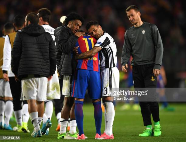 Juan Cuadrado of Juventus and Dani Alves of Juventus embrace Neymar of Barcelona after the UEFA Champions League Quarter Final second leg match...