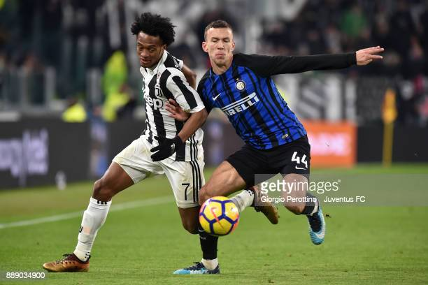 Juan Cuadrado of Juventus and Ivan Perisic of FC Internazionale compete for the ball during the Serie A match between Juventus and FC Internazionale...