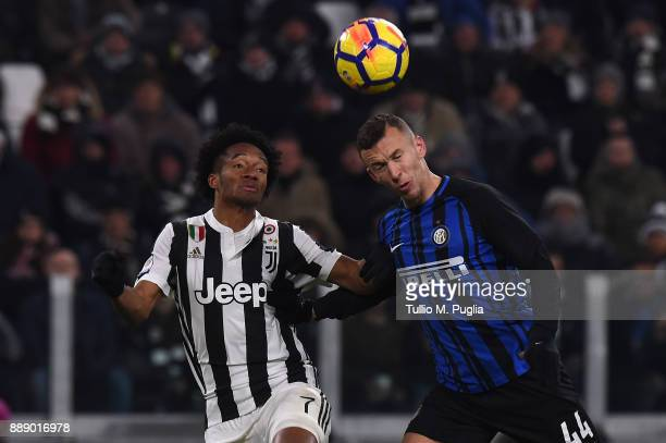 Juan Cuadrado of Juventus and Ivan Perisic of Internazionale compete for the ball during the Serie A match between Juventus and FC Internazionale on...