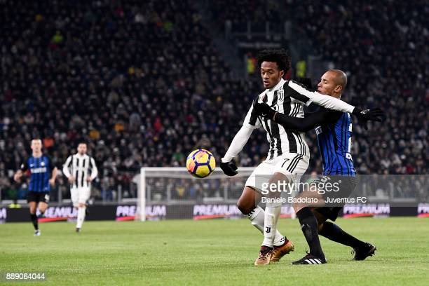 Juan Cuadrado of Juventus and Joao Miranda of FC Internazionale compete for the ball during the Serie A match between Juventus and FC Internazionale...