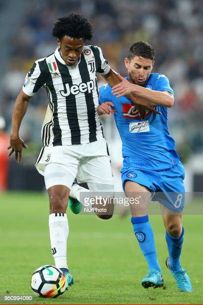 Juan Cuadrado of Juventus and Jorginho of Napoli at Allianz Stadium in Turin Italy on February 22 during Juventus v SSC Napoli