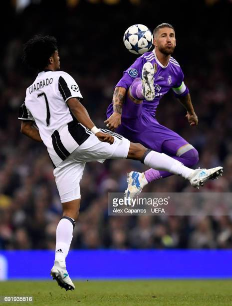 Juan Cuadrado of Juventus and Sergio Ramos of Real Madrid battle for possession during the UEFA Champions League Final between Juventus and Real...