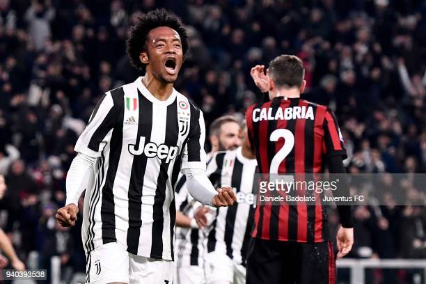 Juan Cuadrado of Juventus celebrates after his goal of 21 during the serie A match between Juventus and AC Milan at Allianz Stadium on March 31 2018...