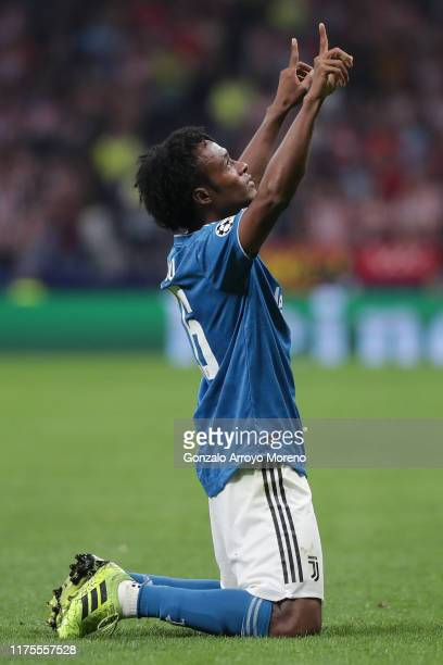 Juan Cuadrado of Juventus celebrates after scoring his sides first goal during the UEFA Champions League group D match between Atletico Madrid and...