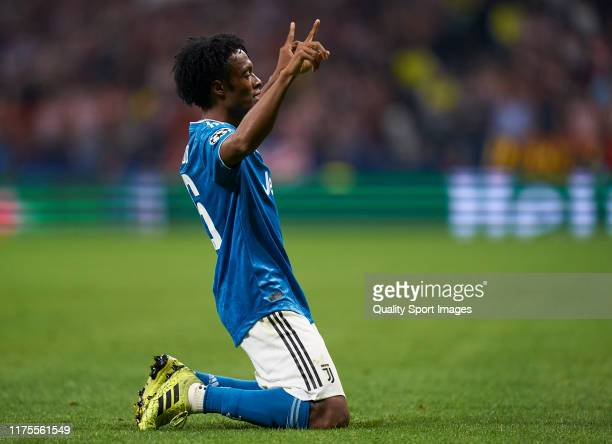 Juan Cuadrado of Juventus celebrates after scoring his team's first goal during the UEFA Champions League group D match between Atletico Madrid and...