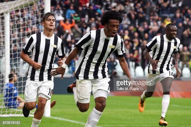 Juan Cuadrado of Juventus celebrates after scoring his team's second goal during the Serie A match between Juventus and Benevento Calcio on November...