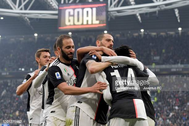 Juan Cuadrado of Juventus celebrates after scoring the goal of 20 with teammates Daniele Rugani Gonzalo Higuain Leonardo Bonucci and Blaise Matuidi...