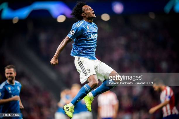 Juan Cuadrado of Juventus celebrates after scoring the opening goal during the UEFA Champions League group D match between Atletico Madrid and...