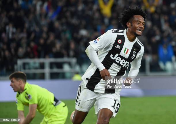Juan Cuadrado of Juventus celebrates his first goal during the Serie A match between Juventus and Cagliari on November 3 2018 in Turin Italy