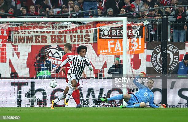 Juan Cuadrado of Juventus celebrates scoring his team's second goal past Manuel Neuer of Bayern Muenchen during the UEFA Champions League round of 16...