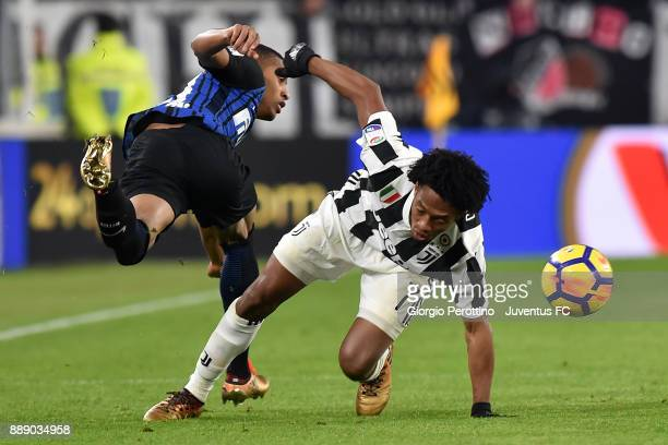 Juan Cuadrado of Juventus clashes with Dalbert Henrique of FC Internazionale during the Serie A match between Juventus and FC Internazionale on...