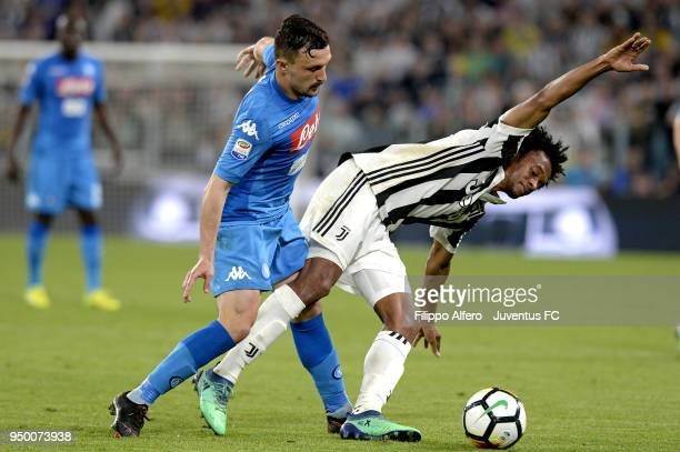 Juan Cuadrado of Juventus competes for the ball with Mario Rui of SSC Napoli during the serie A match between Juventus and SSC Napoli on April 22...