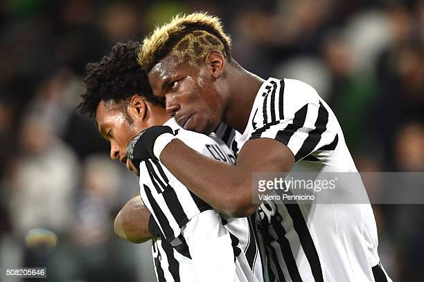 Juan Cuadrado of Juventus FC celebrates after scoring the opening goal with team mate Paul Pogba during the Serie A match between Juventus FC and...