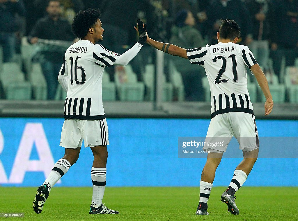 Juan Cuadrado (L) of Juventus FC celebrates his goal with his team-mate Paulo Dybala (R) during the Serie A match betweeen Juventus FC and ACF Fiorentina at Juventus Arena on December 13, 2015 in Turin, Italy.