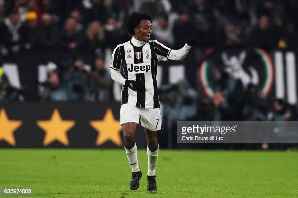 Juan Cuadrado of Juventus FC celebrates scoring the opening goal during the Serie A match between Juventus FC and FC Internazionale at Juventus...
