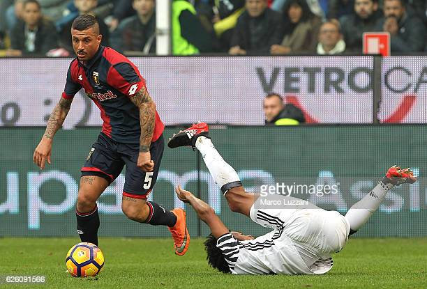 Juan Cuadrado of Juventus FC clashes with Armando Izzo of Genoa CFC during the Serie A match between Genoa CFC and Juventus FC at Stadio Luigi...