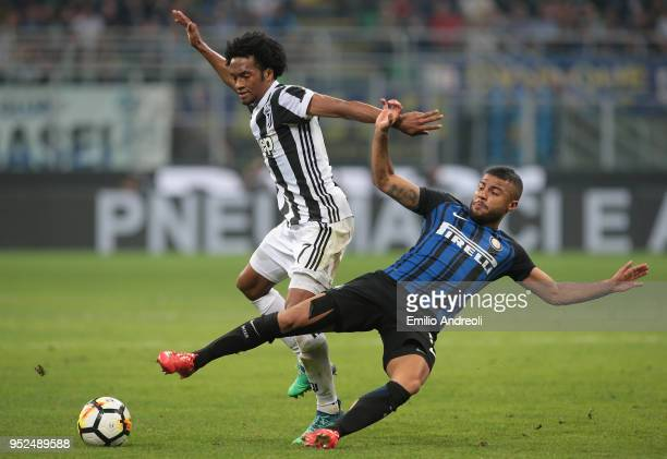 Juan Cuadrado of Juventus FC competes for the ball with Rafinha Alcantara of FC Internazionale Milano during the serie A match between FC...