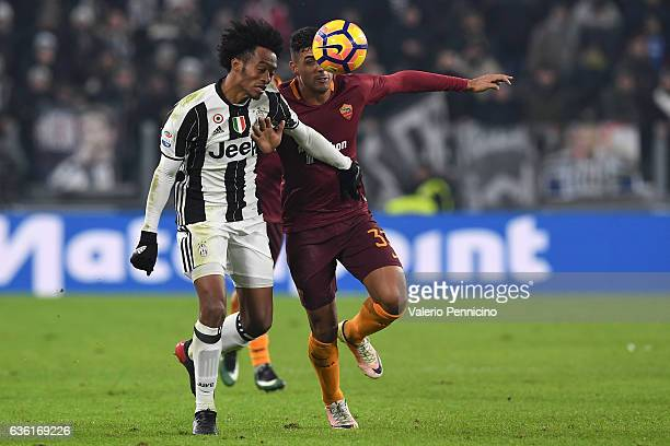Juan Cuadrado of Juventus FC competes with Emerson of AS Roma during the Serie A match between Juventus FC and AS Roma at Juventus Stadium on...