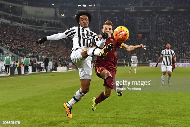 Juan Cuadrado of Juventus FC competes with Lucas Digne of AS Roma during the Serie A match between Juventus FC and AS Roma at Juventus Arena on...