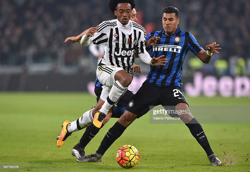 Juan Cuadrado (L) of Juventus FC is tackled by Jeison Murillo of FC Internazionale Milano during the TIM Cup match between Juventus FC and FC Internazionale Milano at Juventus Arena on January 27, 2016 in Turin, Italy.