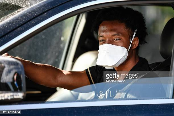Juan Cuadrado of Juventus FC wearing a face mask arrives by car to the Continassa training ground to attend a training session Serie A group...