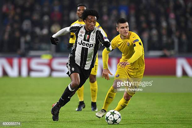 Juan Cuadrado of Juventus in action against Amer Gojak of GNK Dinamo Zagreb during the UEFA Champions League Group H match between Juventus and GNK...
