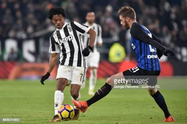 Juan Cuadrado of Juventus in action against David Santon of FC Internazionale during the Serie A match between Juventus and FC Internazionale on...