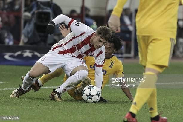 Juan Cuadrado of Juventus in action against Leonardo Kutris of Olympiacos FC during the UEFA Champions League soccer match between Olympiacos FC and...