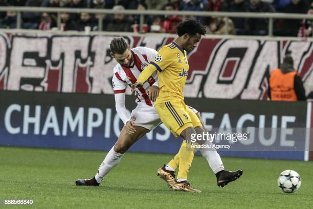 Juan Cuadrado of Juventus in action against Panagiotis Tachtsidis of Olympiacos FC during the UEFA Champions League soccer match between Olympiacos...