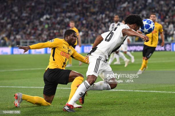 Juan Cuadrado of Juventus in action as Roger Assale of Young Boys tackles during the Group H match of the UEFA Champions League between Juventus and...