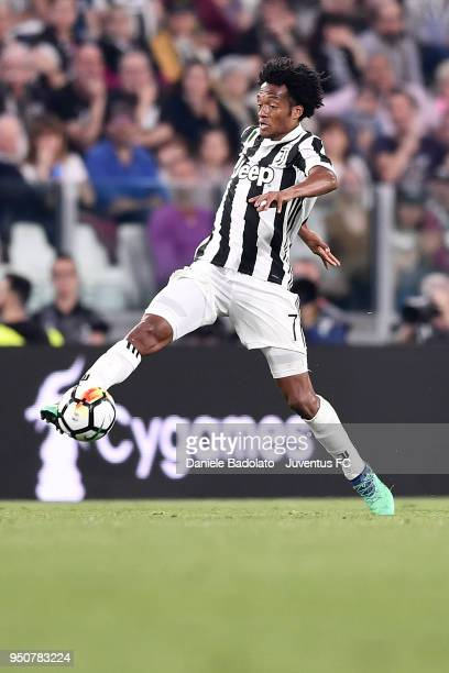 Juan Cuadrado of Juventus in action during the serie A match between Juventus and SSC Napoli on April 22 2018 in Turin Italy