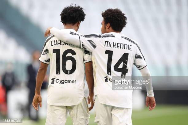 Juan Cuadrado of Juventus is congratulated by team mate Weston McKennie after scoring a late penalty to give the side a 3-2 lead during the Serie A...