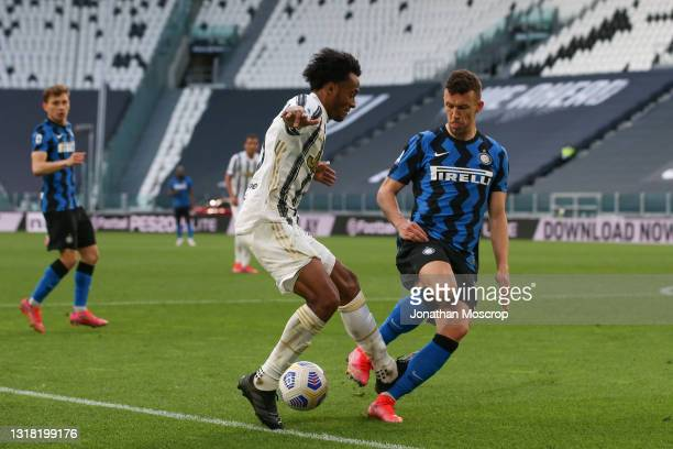 Juan Cuadrado of Juventus is fouled in the penalty area by Ivan Perisic of Internazionale conceeding a late penalty during the Serie A match between...