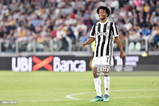 Juan Cuadrado of Juventus looks dejected during the Serie A match between Juventus and Napoli at Allianz Stadium Turin Italy on 22 April 2018