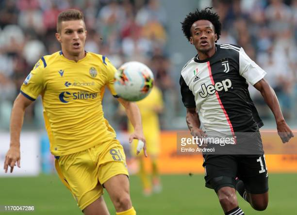 Juan Cuadrado of Juventus runs after the ball during the Serie A match between Juventus and Hellas Verona at Allianz Stadium on September 21 2019 in...