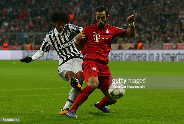 Juan Cuadrado of Juventus scores his team's second goal during the UEFA Champions League round of 16 second Leg match between FC Bayern Muenchen and...