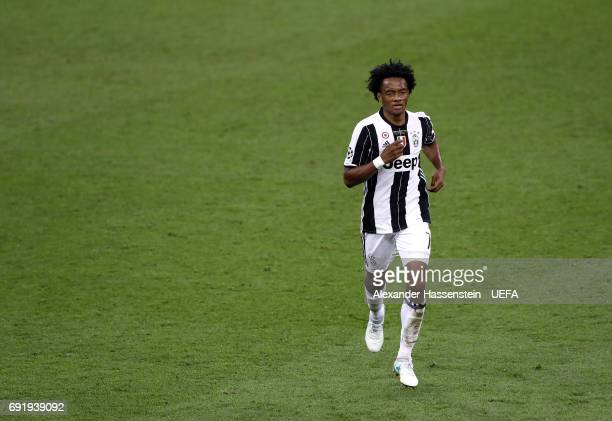 Juan Cuadrado of Juventus walks off after being sent off during the UEFA Champions League Final between Juventus and Real Madrid at National Stadium...