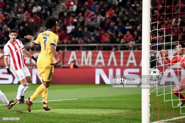 Juan Cuadrado scores first goal for Juventus during the UEFA Champions League group D match between Olympiakos Piraeus and Juventus at Juventus...