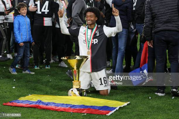 Juan Cuadrado with the trophy of Scudetto during the victory ceremony following the Italian Serie A last football match of the season Juventus versus...