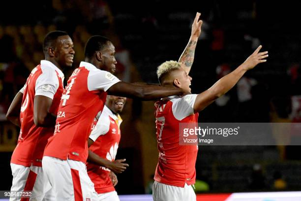 Juan Daniel Roa of Independiente Santa Fe celebrates with teammates after scoring the third goal of his team during a match between Independiente...