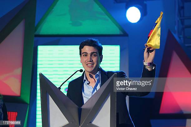 Juan David Aristizabal receives a Millennial Award on stage during the MTV Millennial Awards 2013 at Foro Corona on July 16 2013 in Mexico City Mexico